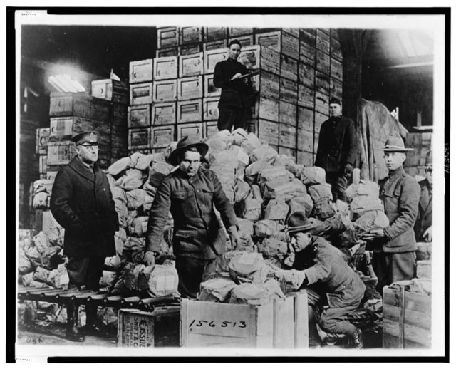 Packing shipment of Matzoths [i.e. matzos] for the 77th Division for men of Jewish faith in the A.E.F. for the Passover Holiday, at Warehouse #40, Q.M.C. Depot, St. Denis [France] / Signal Corps. U.S.A.