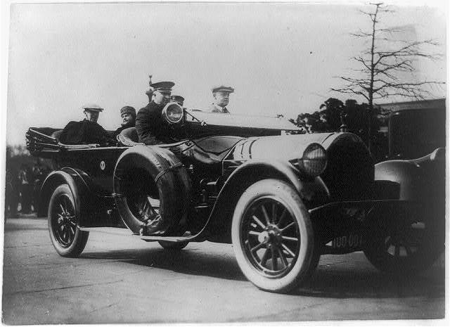 [President & Mrs. Wilson on first auto ride after his illness]