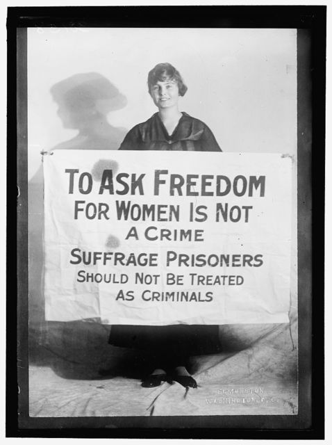 WOMAN SUFFRAGE. LUCY BRANHAM WITH POSTERS