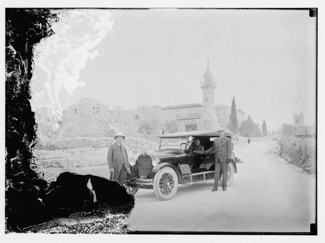 3 men with new Dodge auto