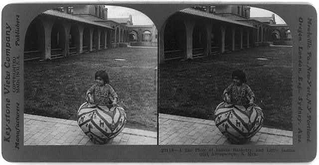 A fine piece of Indian basketry, and little Indian girl, Albuquerque, N.M.