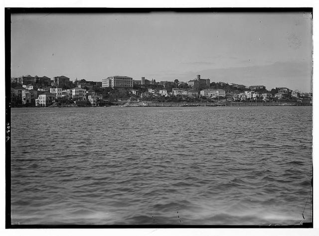American University. Beirut, (A.U.B.). The campus from the sea. Showing left to right: The medical, the museum (Post Hall), the chapel, College Hall and chemistry bldg's