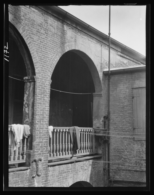 Arched balcony in a courtyard, New Orleans