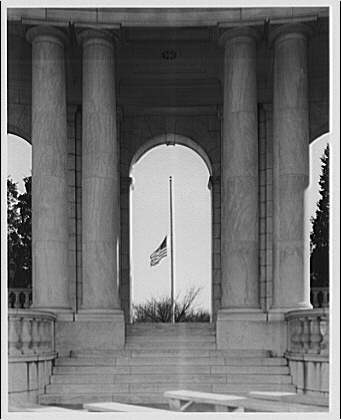 Arlington National Cemetery. Flag at half-mast through door of Arlington National Cemetery Amphitheater