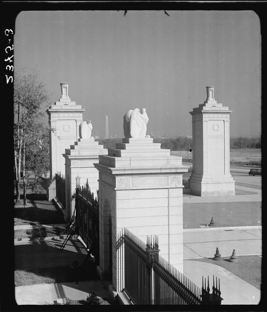 Arlington National Cemetery. Gates in foreground, showing city of Washington, D.C. in background III