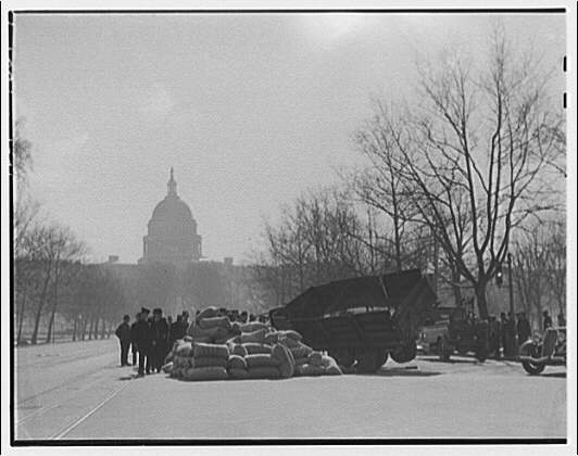 Avenues and streets. Load of feed spilled on Pennsylvania Ave. in front of U.S. Capitol