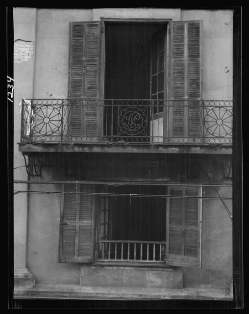 Balcony and windows of the first skyscraper, 638 Royal Street, New Orleans