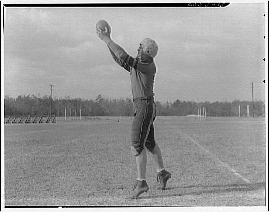 Charlotte Hall Military Academy. Football player, catching ball