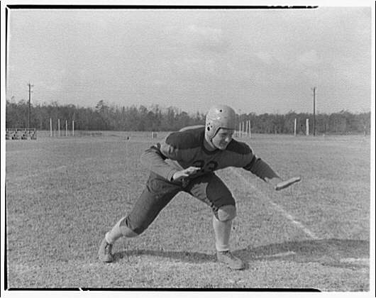 Charlotte Hall Military Academy. Football player, in defensive stance