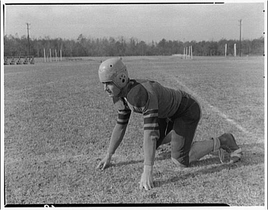 Charlotte Hall Military Academy. Football player, on hands and knees
