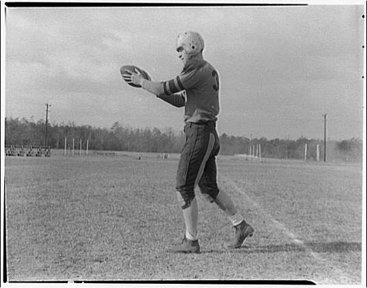 Charlotte Hall Military Academy. Football player, preparing to kick ball