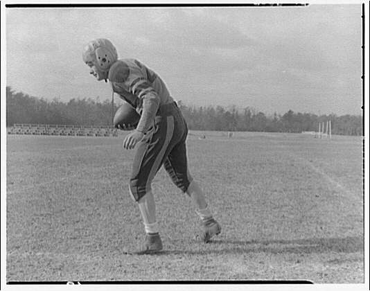 Charlotte Hall Military Academy. Football player, running