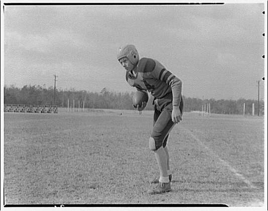 Charlotte Hall Military Academy. Football player, upright with ball