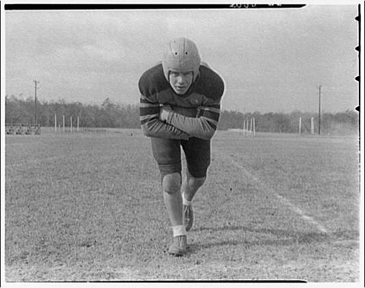 Charlotte Hall Military Academy. Football player, with arms crossed