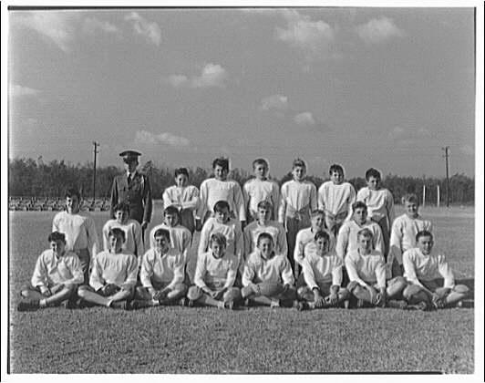 Charlotte Hall Military Academy. Portrait of football team in light jerseys