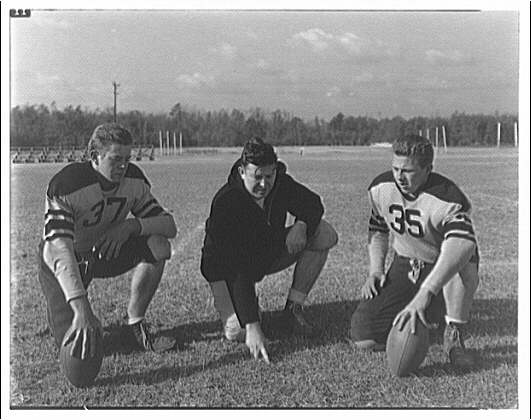 Charlotte Hall Military Academy. Two football players and coach
