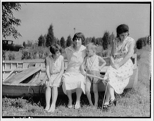 Children visit Pine Whip, Maryland (Art Brown). Children and women
