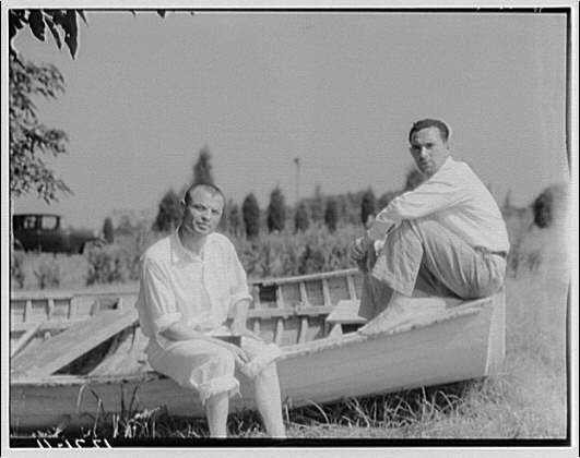 Children visit Pine Whip, Maryland (Art Brown). Horydczak and friend seated on boat