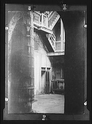 Cistern and outer stairs of an old-time courtyard, New Orleans