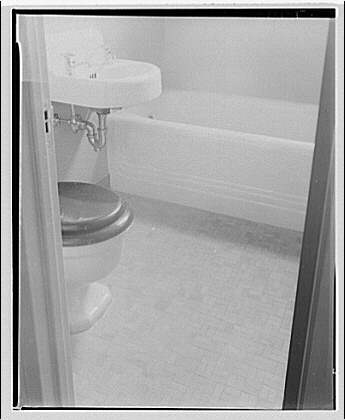 Colored housing for Federal Housing Administration. Interior of bathroom with tile floor