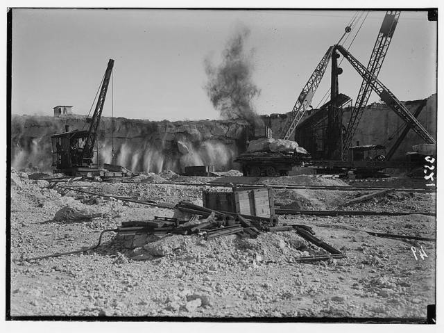 Construction of the Haifa Harbor. The Athlit quarries. Exploding of a great blast