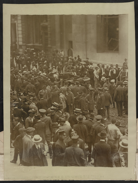 Crowd after Wall Street bomb outrage today ... one of the mobs which pushed everywhere trying to get word of friends or relatives following the bomb explosion in the office of J.P. Morgan & Co. at Broad and Wall Streets which killed at least 15 and injured hundreds ... / / Underwood & Underwood.