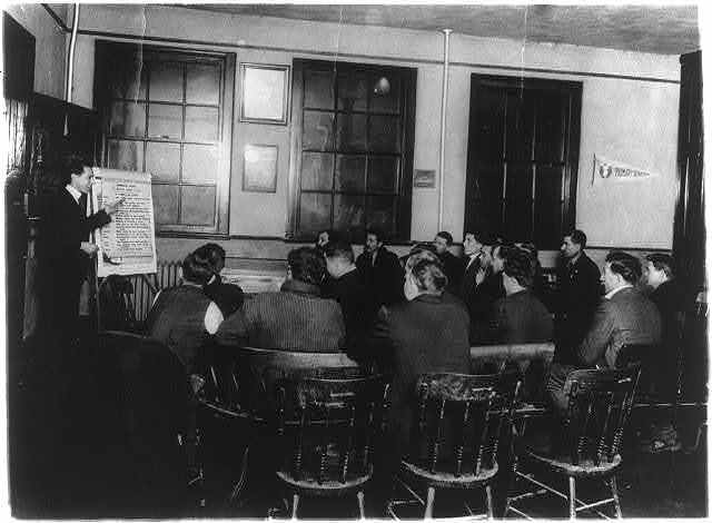 Department of Labor, training service. Italian class receiving instruction in English and citizenship, Newark, N.J. Y.M.C.A.