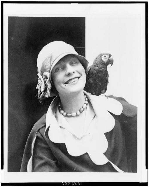 [Dorothy Tierney, head-and-shoulders portrait, facing front, with her parrot on her shoulder]