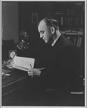 Dr. Joseph Quincy Adams, first director of the Folger Library. Dr. Adams at desk I