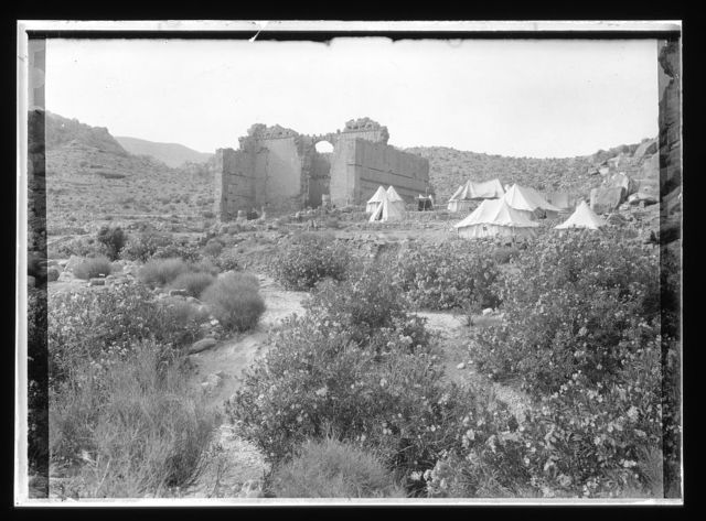 [El-Habis area. Qasr Bint Far'on. Cook's camp at Petra, near remains of Roman Temple]