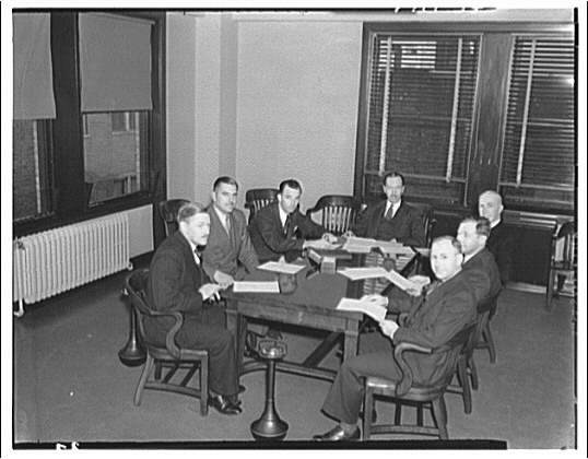 Electric Institute of Washington snap shots for movies and films. Seven men at conference table
