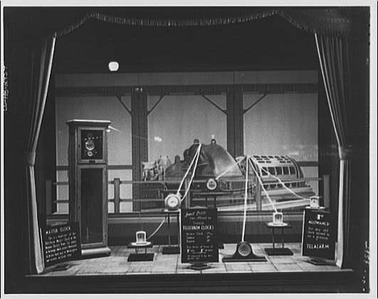 Electric Institute of Washington. Window display of telechron clocks