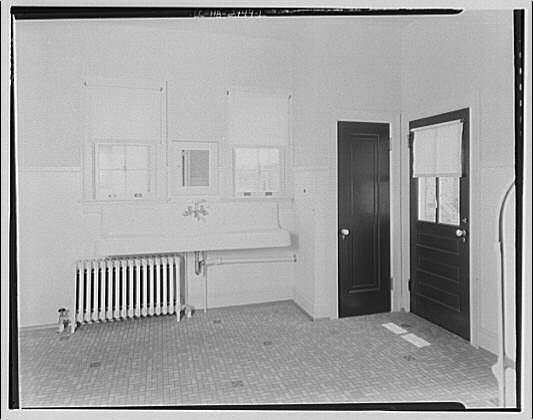 Electric League of Washington electric home. Room with sink and radiator