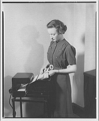 Endorsograph Co. Woman standing at machine I