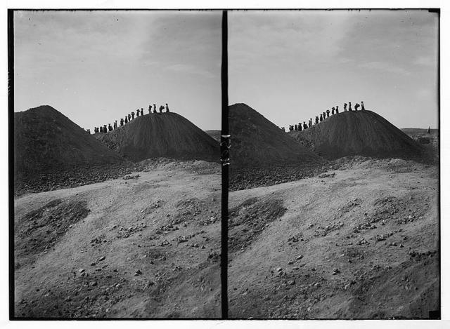 Excavations. Ain Shems (Beth Shemesh) on the Sharon Plain. Beth Shemesh excavations. The dumps. Line of basket women silhouetted against horizon