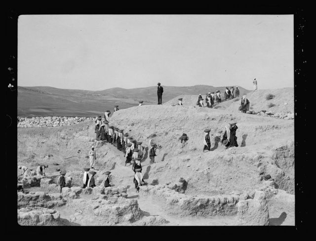 Excavations. Ain Shems (Beth Shemesh) on the Sharon Plain. Lines of basket women carrying earth to the dump
