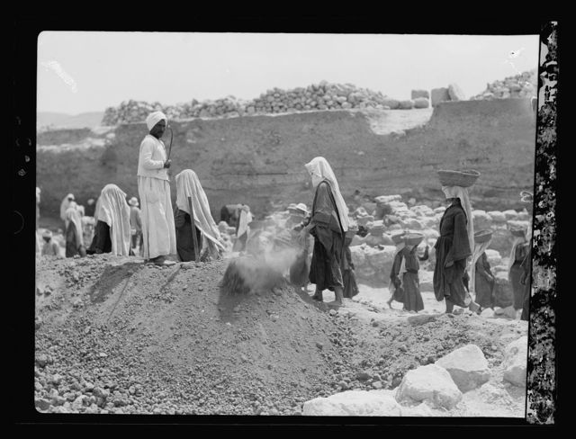 """Excavations. Ain Shems (Beth Shemesh) on the Sharon Plain. The Egyptian """"task master"""" speeding up the workers"""