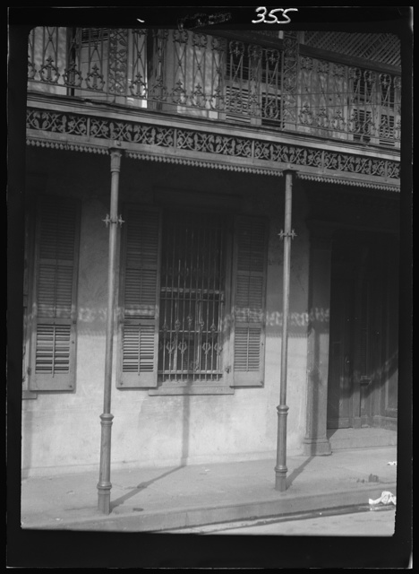 Facade of a multi-story building with a balcony in the French Quarter, New Orleans