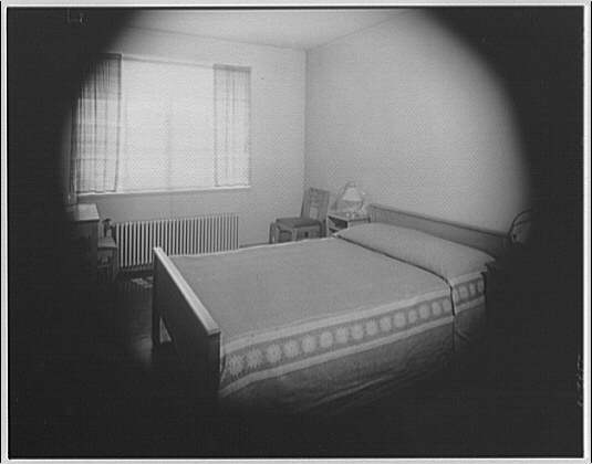 Federal Housing Administration. Masked view of bed in room