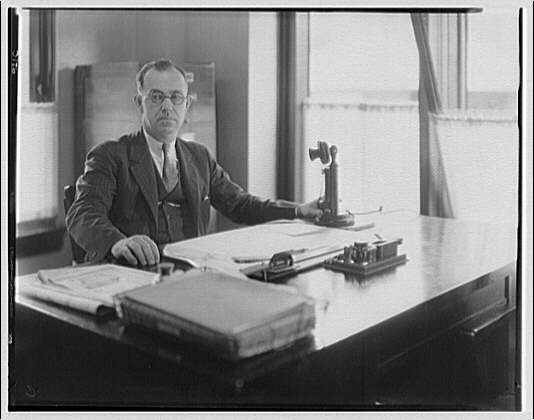 George L. Coyle. Portrait of George L. Coyle at desk III