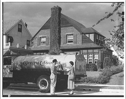 Griffith Consumers Co. Woman inspecting meter on tank
