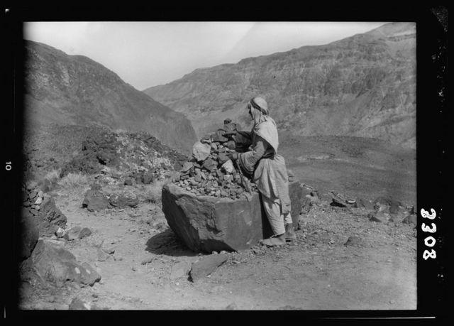 "Herod's hot baths of Callirrhoe. Wady Zerka Main. A pile of ""Witness"" stones, ""Shawahid"""