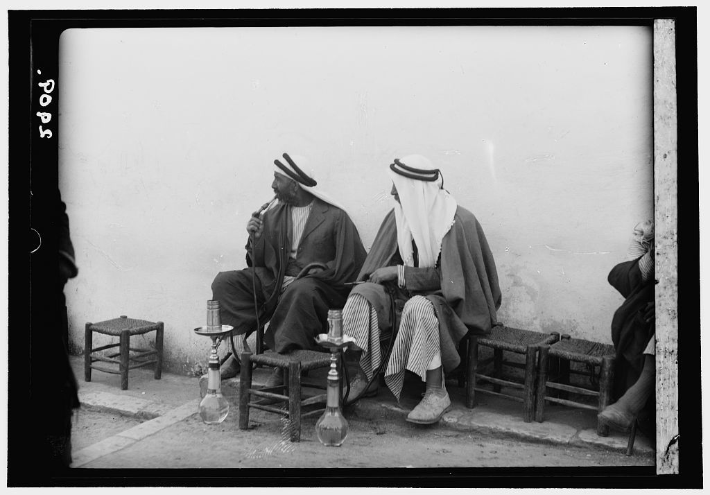 Jerusalem. The Old City. Street coffee shop. Men smoking nargilies