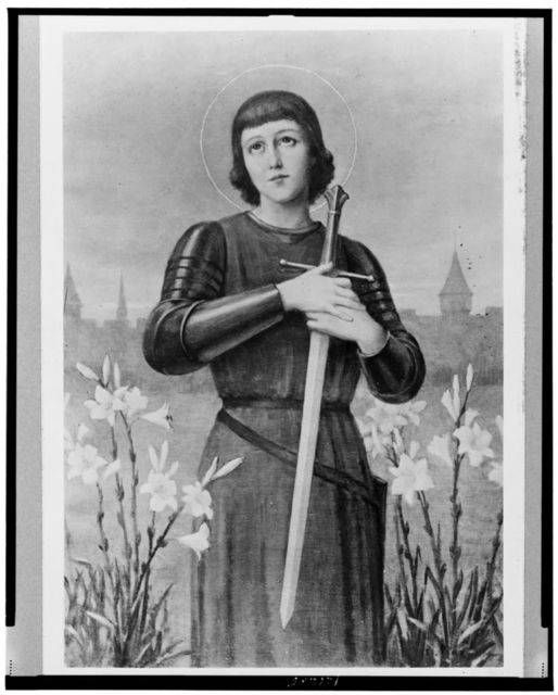 [Joan of Arc, three-quarter length portrait, standing in field, facing front, clutching sword to chest]