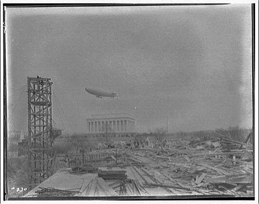 Lincoln Memorial. Army blimp over Lincoln Memorial with construction materials for Memorial Bridge in foreground