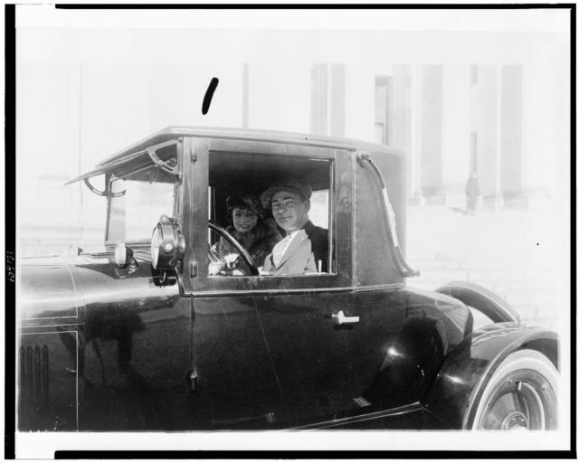 [Man and woman, in automobile, in the Washington, D.C., area]