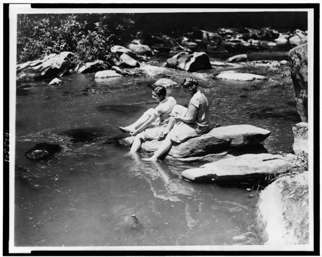Marion Newton and Ruth Williams preparing to wade in Rock Creek, after suffering with the intense heat of the past two days, when the thermometer recorded 104 degrees