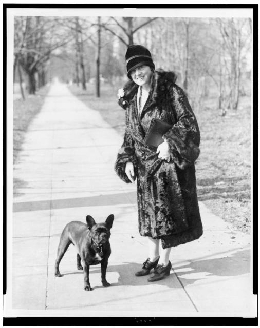 Mary Roberts Rinehart, well known writer, snapped while out for a stroll with her favorite pet
