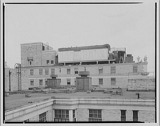 Mayflower Hotel. Construction of air conditioning on roof of Mayflower Hotel VI