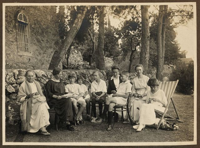 [Members of the American Colony in Jerusalem, seated outside at the American Colony summer home at Ein Karim (Ain Karim)]